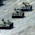 FILE PHOTO 5JUN89 – A Peking citizen stands passively in front of a convoy of tanks on the Avenueof..