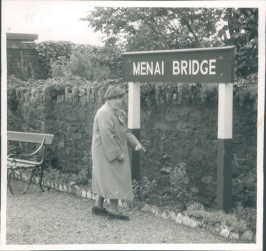 Photograph-Anglesey-Lady-Stood-Near-Menai-Bridge-Sign.jpg