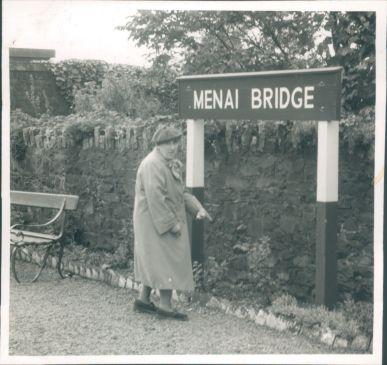 Photograph-Anglesey-Lady-Stood-Near-Menai-Bridge-Sign.jpg